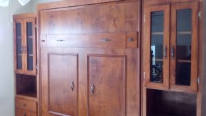 Cherry wood murphy bed with glass side cabinets
