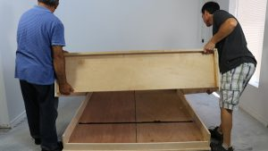 Raising the wall bed cabinet off the floor