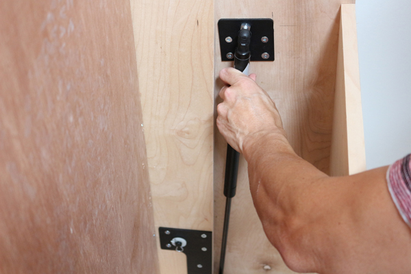 pushing in the end fitting on Murphy bed hardware