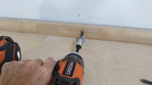 Anchoring wallbed cabinet to wall in the room