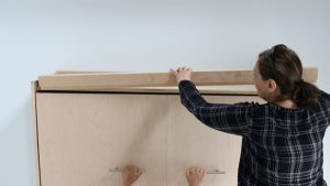 installing the cabinet top stopper on wall bed cabinet