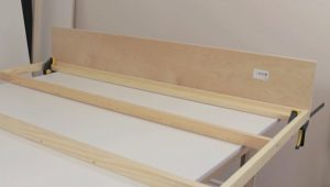Attaching header board to bed frame step 1