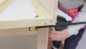 Attaching header board to Murphy bed frame step 4