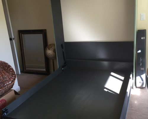 open murphy bed in black paint finish