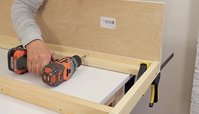 attaching header board to wall bed