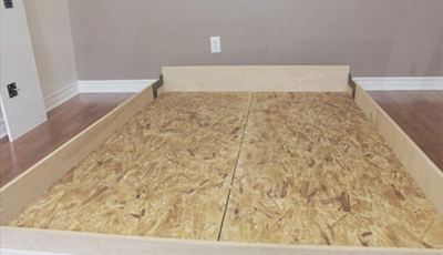 Attaching mattress supports to wall bed frame