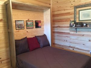open murphy bed with pilows