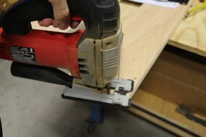 Cutting side rails of wall bed with jig saw