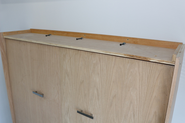 Wall bed cabinet with lag bolts removed