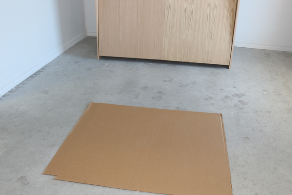 Card board on floor to protect wall bed frame