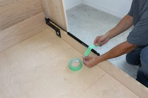 Taping wall bed pistons to bed side rail for storage