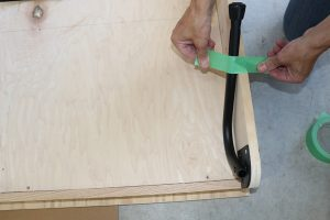 Taping the fold-up legs onto bed frame on wall bed