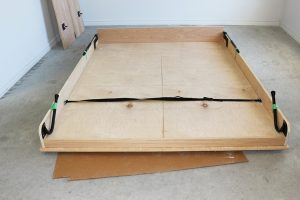 Murphy bed frame on floor ready to be moved or stored